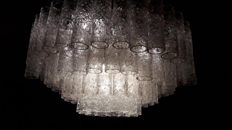 Murano glass chandelier, with 128 pieces in glass cannulas, with 9 light points, Mid-Century Modern, Italy 1960, by Nason. The chandelier is in transparent white art glass. Measures: Each piece is 13 cm. high, 4 cm. wide.
