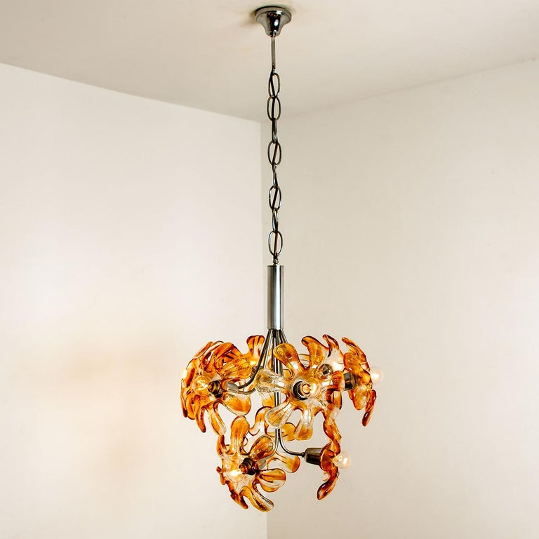 Elegant Murano chandelier by Mazzega, 1960s. Chrome chain and hardware. Amber and clear resembles flowers. The chandelier illuminates beautifully on wall and ceiling. Measures: Ø 19 inch/ 48 cm, 24 inch H 60 cm  Cleaned well wired and ready to