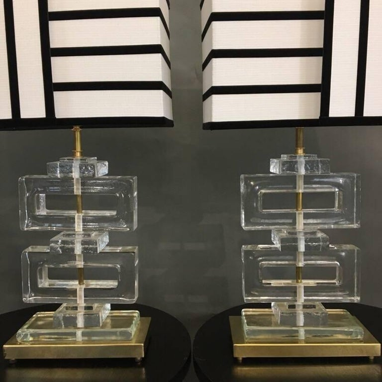 Murano clear glass lamps with striped black and white lampshades, handcrafted by us.  The rectangular base is in brass, the geometric clear glass bloks are thick and heavy. The black stripes are in velvet.