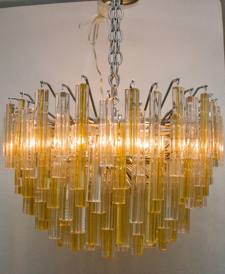 This stylish and chic Murano glass, Venini chandelier is one of the rarer color combinations of clear and golden yellow and the piece dates to the 1970s.  Note: The piece has been professionally rewired.  Note:  There is one missing gold prism.  The