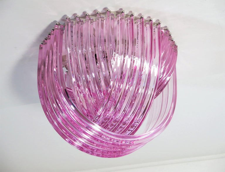 "Murano light pink glass chandelier or ceiling light with four layers of curving ""triedri"" glass prisms on an octagonal chrome structure. A dynamic form, changing as you move around it, due to the overlapping levels of transparent glass with light"