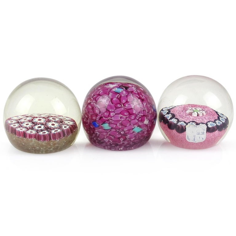 Priced per item (3 designs available, as shown). Beautiful vintage Murano hand blown Italian art glass paperweights. Documented to Fratelli Toso and Alfredo Barbini. The first paperweight has an all-over white millefiori flower design, with dark red