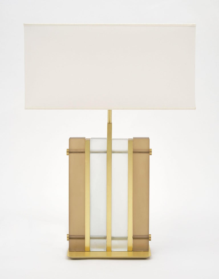 """Murano glass amber """"tormalina"""" slab lamps with beautiful brushed brass structure. We love the hand blown slab glass elements in both a frosted clear and frosted amber hue. These striking; modern fixtures have great impact on a space. They have been"""