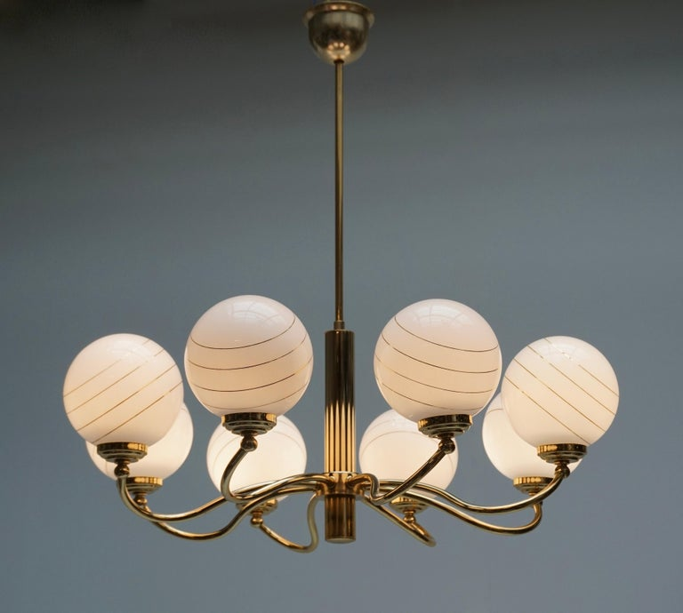 Italian Murano glass and brass eight-arms chandelier.