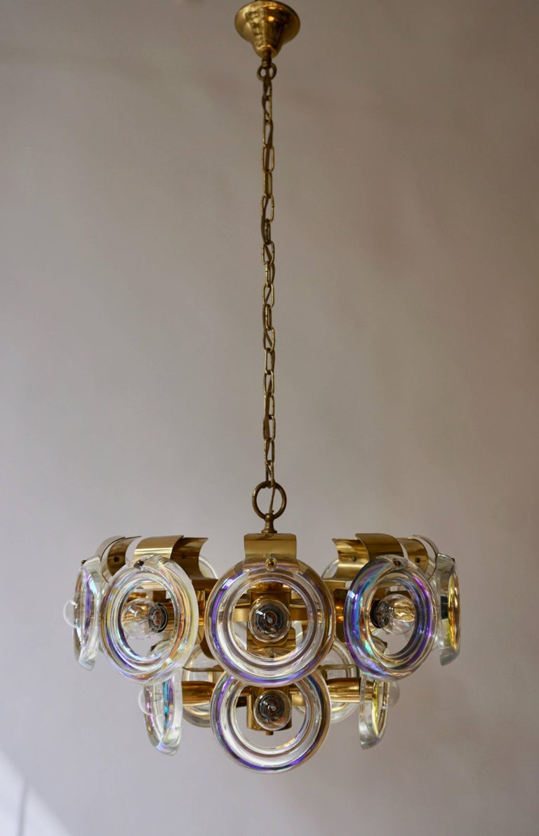 Italian Murano glass chandelier creates a warm and cozy light. The lamp features fifteen-light sources of max 60W. The wires can be made to any desired length. Measures: Diameter 50 cm. Height fixture 28 cm. Total height 110 cm.
