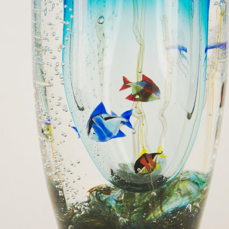 Massive Murano glass vase signed by Romano Donà, manufactured in the 1990s. Rich aquarium details and beautiful color shades.