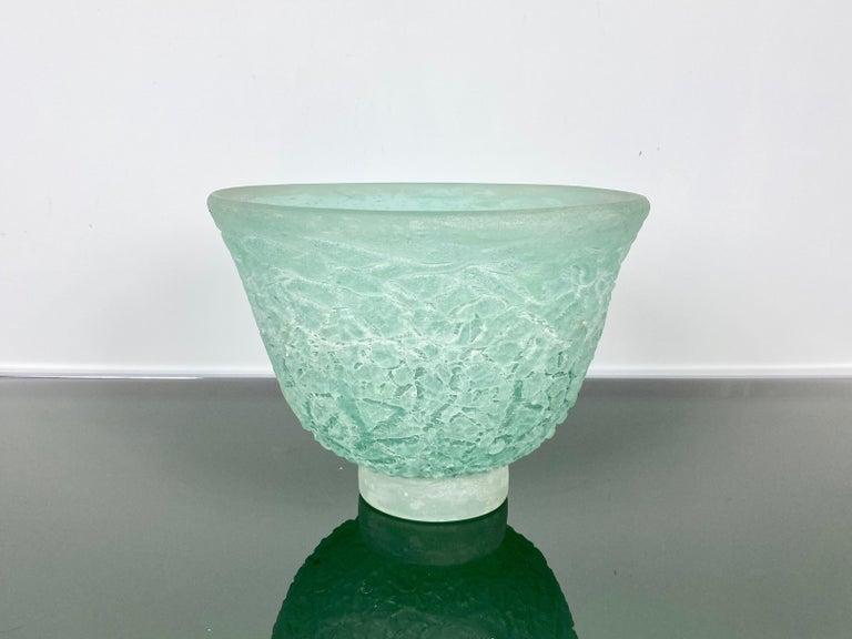 This absolutely gorgeous and monumental signed Italian Murano Cenedese sculptural hand blown glass centre piece bowl is of the scavo technique. It is from the 1970s. The luscious color of the light turquoise mixed in with patches of light black or