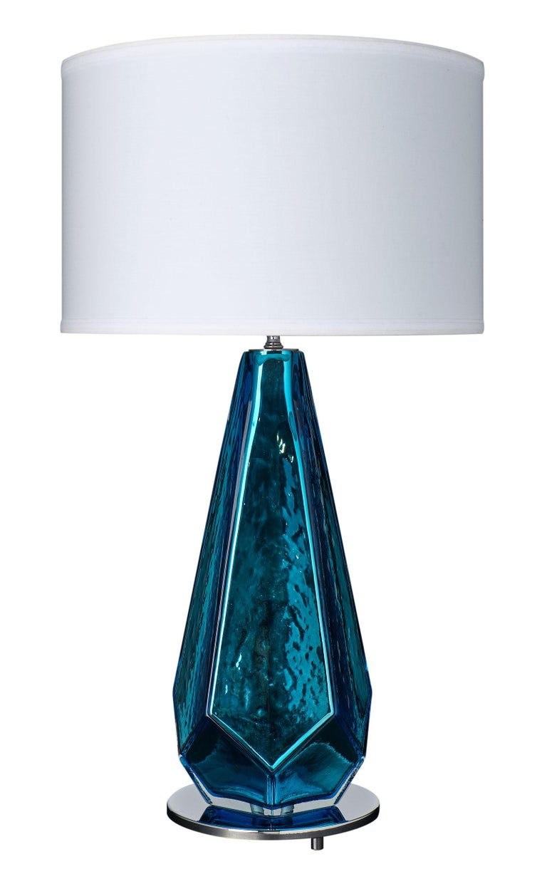 """An important pair of blue """"specchiate"""" Murano glass lamps. This mirrored pair has a striking metallic color and impressive shape. They have been newly wired to fit US standards and sit on a chrome finished base."""