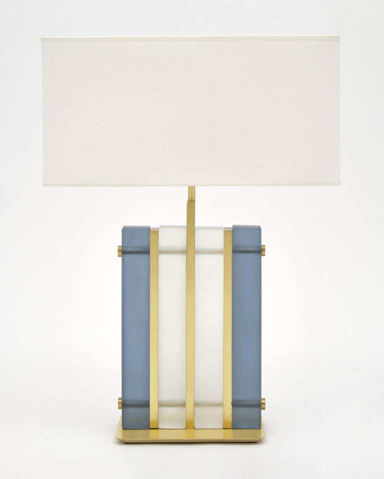 """Murano glass blue """"tormalina"""" slab lamps with beautiful brushed brass structure. We love the hand blown slab glass elements in both a frosted clear and frosted blue hue. These striking; modern fixtures have great impact on a space. They have been"""