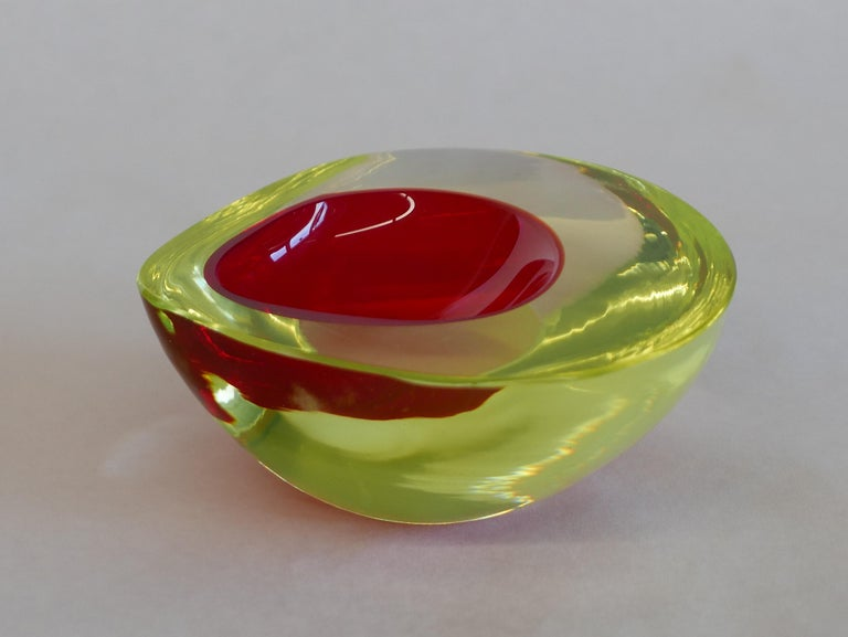 """Antonio da Ros created this design in 1960 for Cenedese doing various piece with uranium glass which almost glows by itself. Made of hand blown glass in the """"Sommerso""""-technique by Vetreria Gino Cenedese, Murano-Italy. In excellent condition, with"""