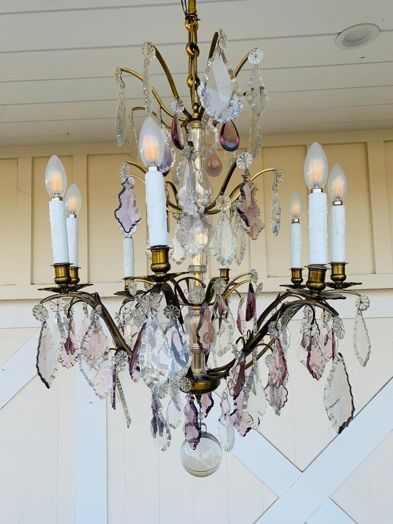 Beautiful murano glass and brass chandelier with 8 arms and candle like lights.