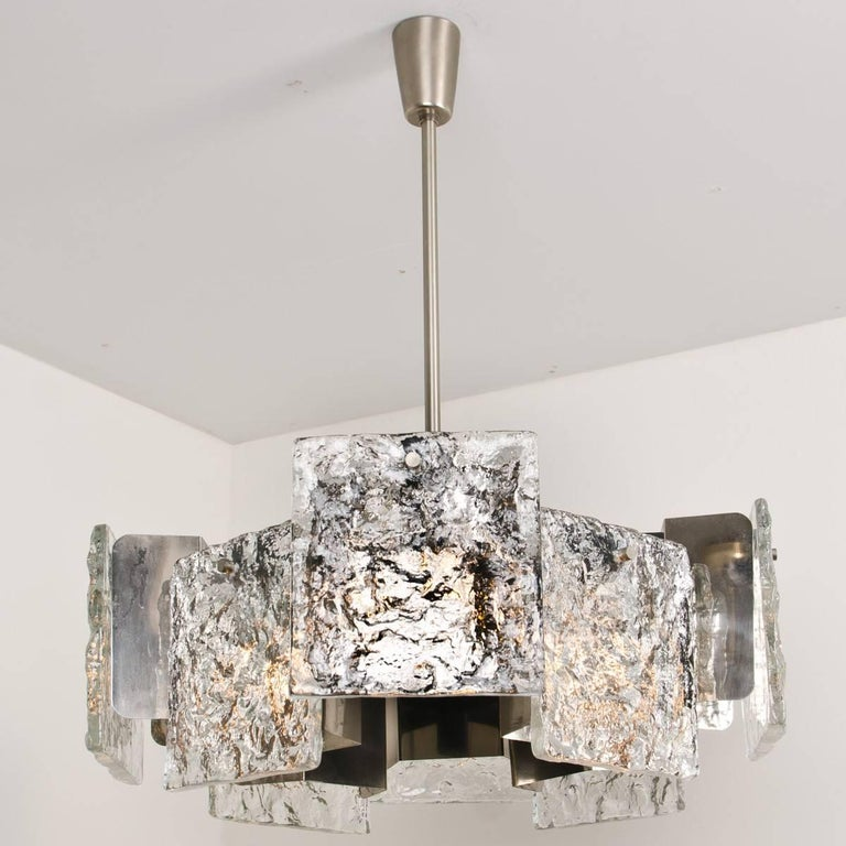This large ceiling lamp was designed and manufactured by J. T. Kalmar, Austria, circa 1960. It takes 16 bulbs and features eight handmade solid glass elements made from Murano glass. The frame is made from chrome-plated and lacquered brass.  Very