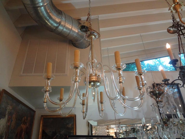 Stunning murano glass chandelier attributed to Seguso. This chic murano glass chandelier has 10-light and an unusual faceted bottom finial. This murano chandelier has been newly wired to U.S. specifications. Our Murano glass chandelier can be hung