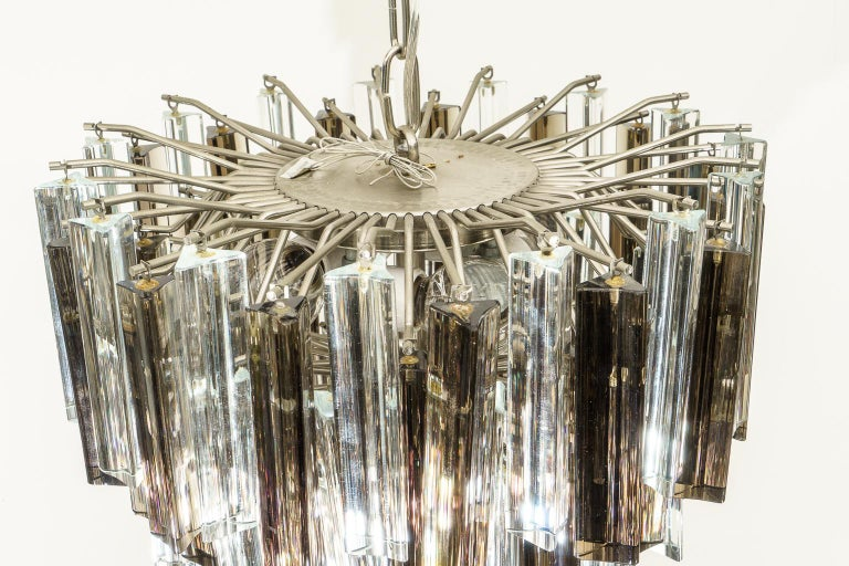 This stylish and chic 1970s Venini Murano glass chandelier will make a definite statement with its clear and smokey topaz prisms which catch the light beautifullly.   Note: Dimensions including the chain are 37