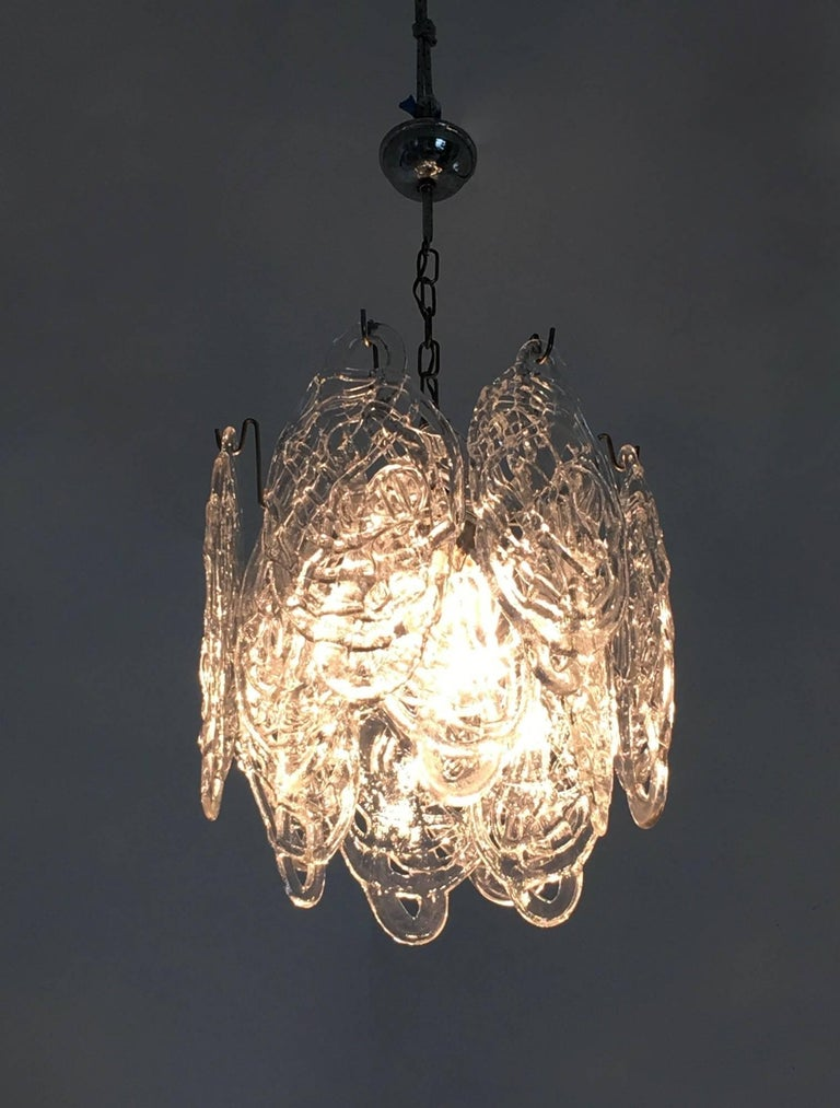 Its lampshade features Murano glasses that have a cobweb design realized by Mazzega, hanging from a nickel-plated metal frame.