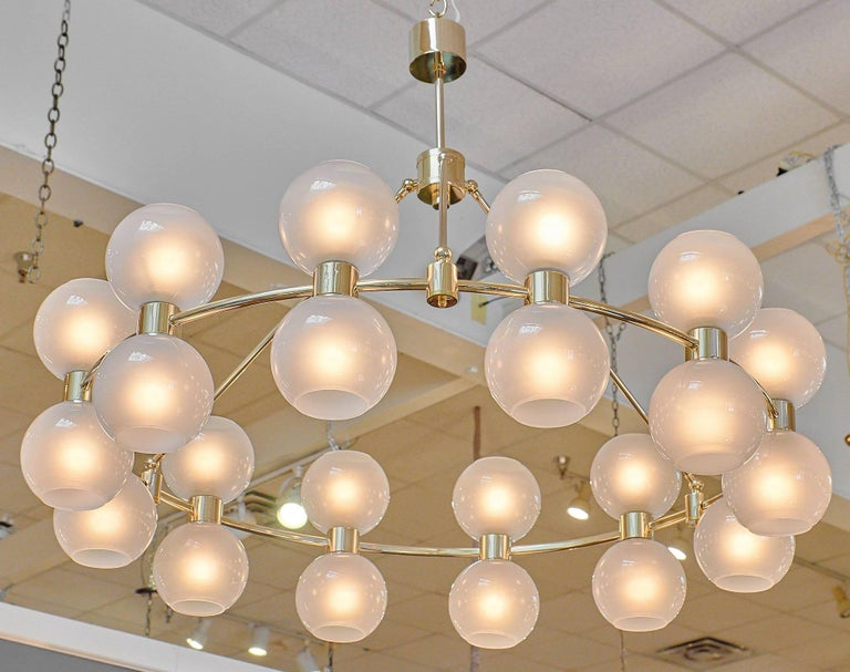An impressive yet elegant Murano glass globe chandelier with a galvanized brass structure featuring 24 frosted Murano glass globes in the manner of Stilnovo. The glass is all handblown. This piece requires 24 medium base bulbs and has been newly