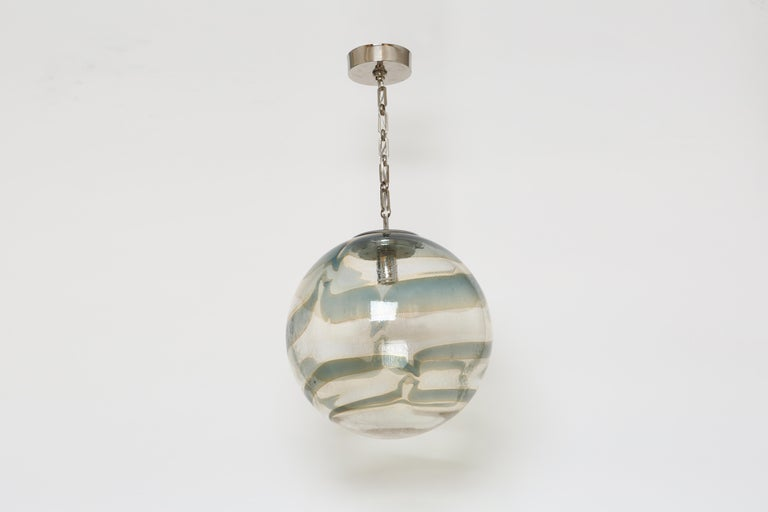Murano glass globe pendant. Italy 1970s. Hand blown glass, nickel-plated chain and canopy.