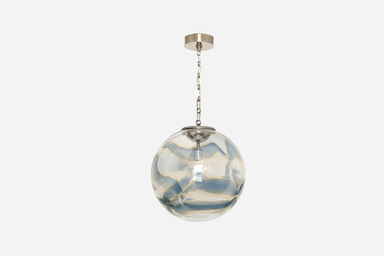 Murano glass globe pendant. Italy, 1970s. Hand blown glass, nickel-plated chain and canopy.