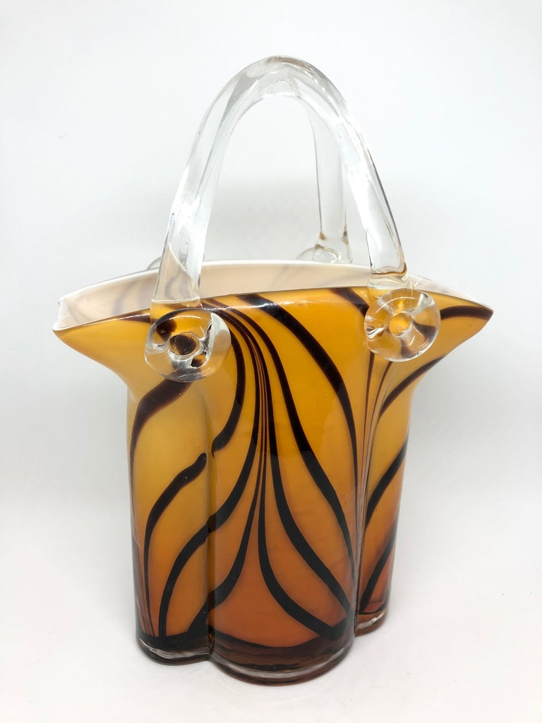 An amazing Venetian Murano glass Mid-Century Modern Sommerso Vase made in Italy, circa 1960s. This is a heavy glass item, white colored inside, outside brown and amber glass. It is in very good condition with no chips, cracks, or flea bites.