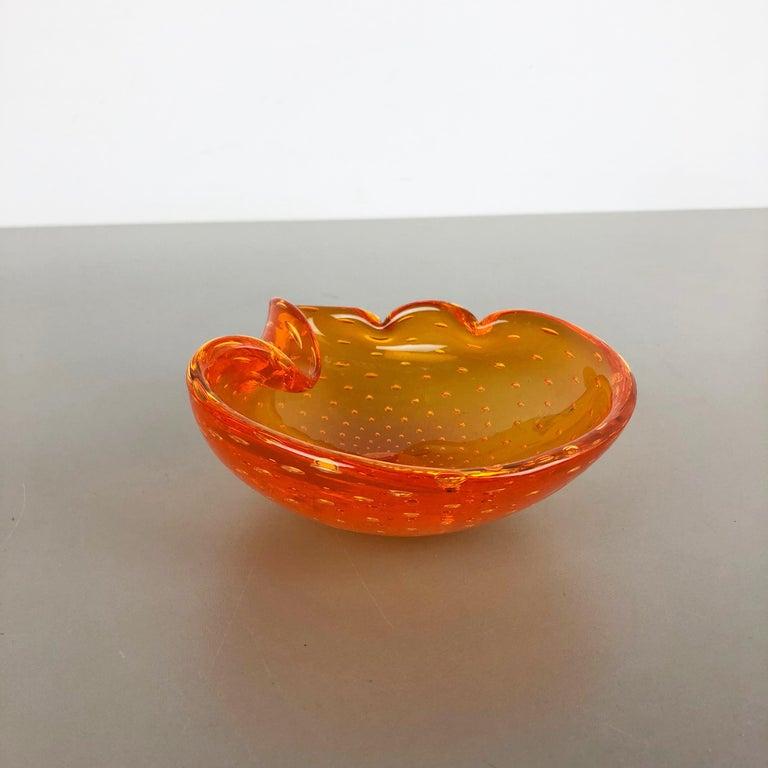 Article:  Murano glass bowl, ashtray element   Origin:  Murano, Italy   Producer:  Seguso dalla Venezia (SDV).   Decade:  1970s    This original vintage glass bowl element, ash tray was produced in the 1970s in Murano, Italy. It