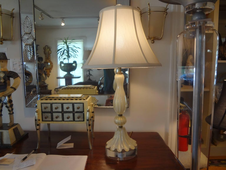 Italian Murano glass lamp on Lucite or acrylic base attributed to Barovier. This Venetian glass lamp is cream colored glass with brass accents and infused with gold. It has been newly wired for the U.S. Market. The shade is not included in the sale.