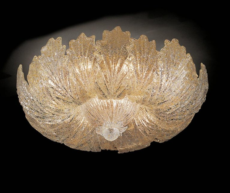 This ceiling light realized in pure Murano glass leaves with gold intrusion. Available also with clear graniglia leaves.  Amazing 24-carat gold-plated structure and canopy. This beautiful ceiling light gives an elegant Ambience a special flair and