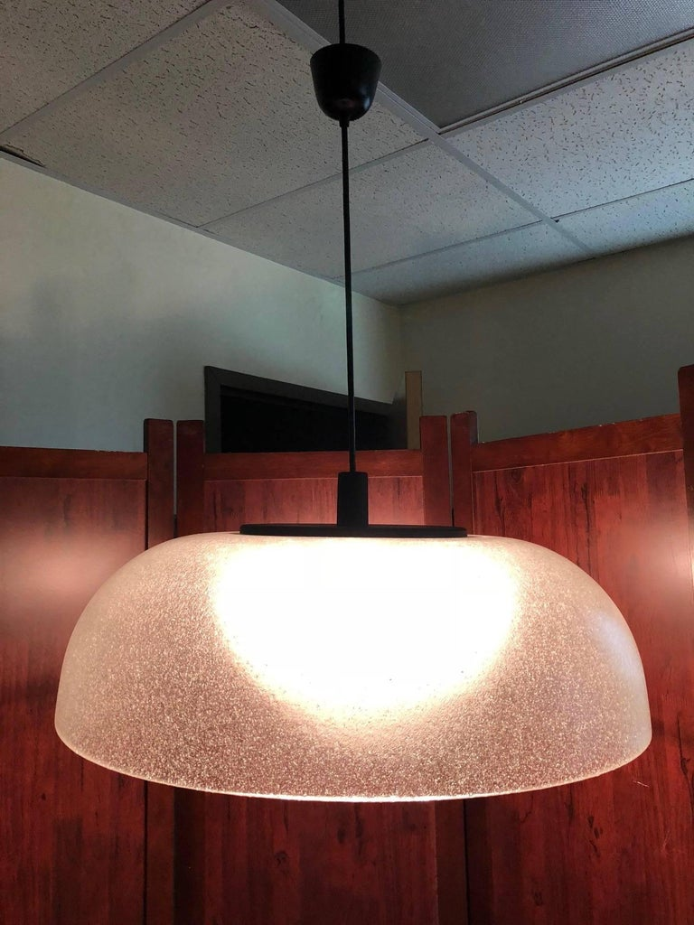 Murano glass light fixture. Has a black metal stem and cap.