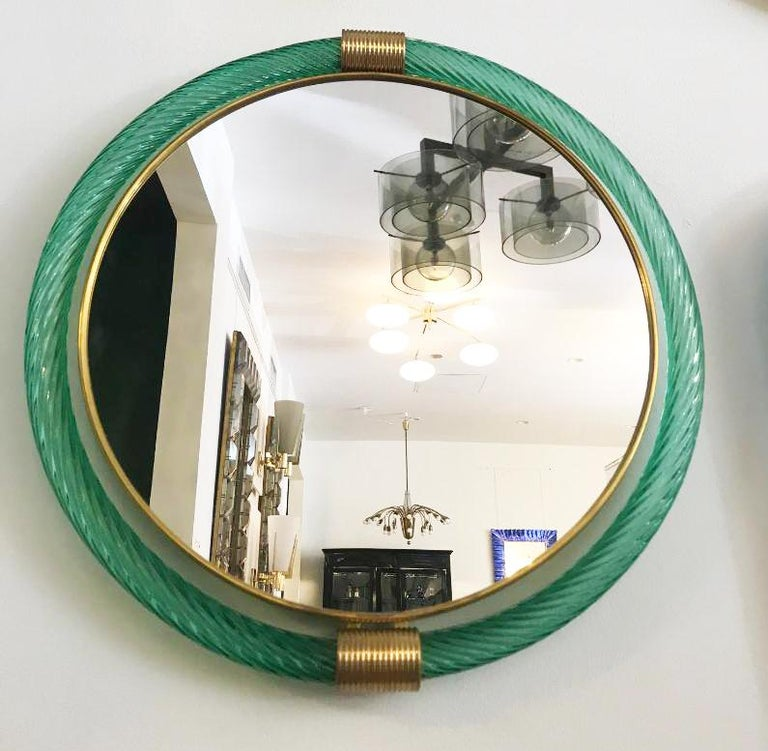 Murano wall hanging mirror by Barovier & Toso. Green glass with brass details, stamped on the back.