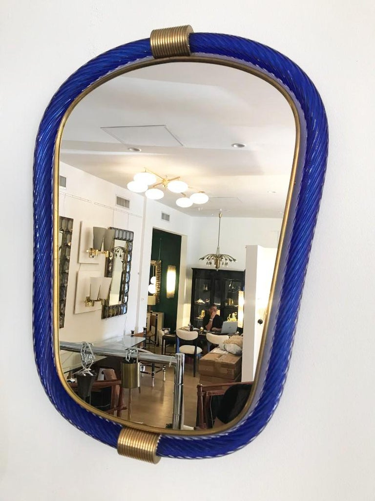 Murano wall hanging mirror by Barovier & Toso. Blue glass with brass details, stamped on the back.