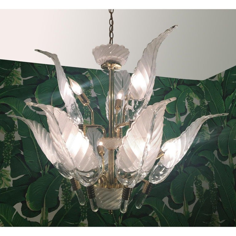 Sculptural glass palm leaf chandelier by Murano features brass frame and nine-light. Clear glass frawns measure: 18