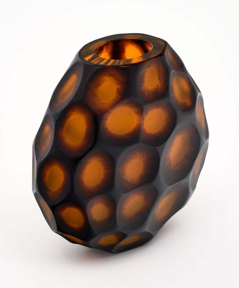 "Murano glass ""pavone"" vase handcrafted and blown. We love this stunning piece with amber hues by Alberto Dona. Crafted by ""molato a diaminte"" or diamond molded. This vase is signed on the bottom."