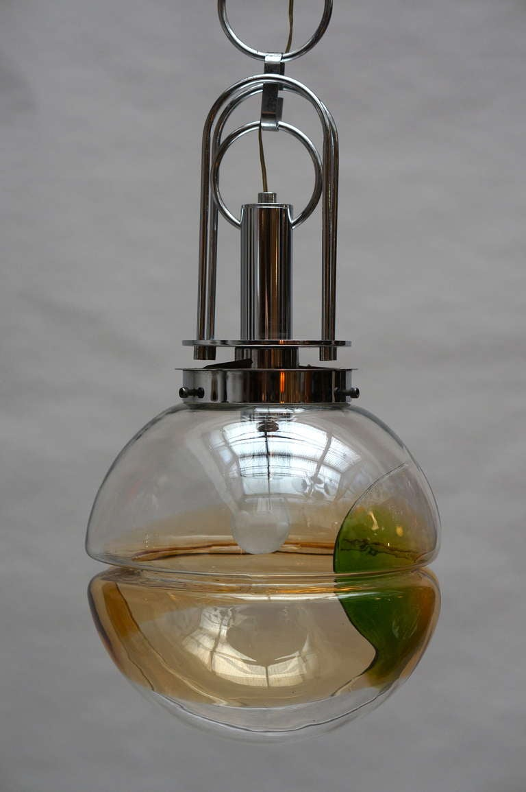 Italian Murano glass pendant light with colored green and yellow glass and chromed metal frame.