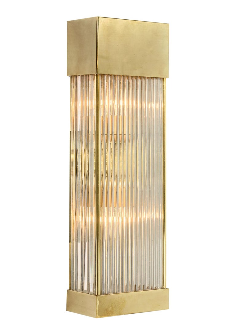 Pair of sconces from Murano, Italy featuring an array of glass rods maintained in bottom and top brass casings. This pair has been newly wired to fit US standards.