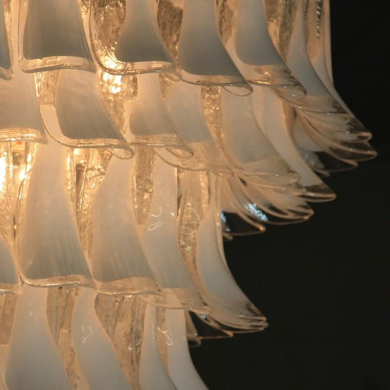 Large Murano 8-tier glass chandelier with well over 140 pieces of 'horse shoe' glass with white coloration. White steel frame construction, Italy.