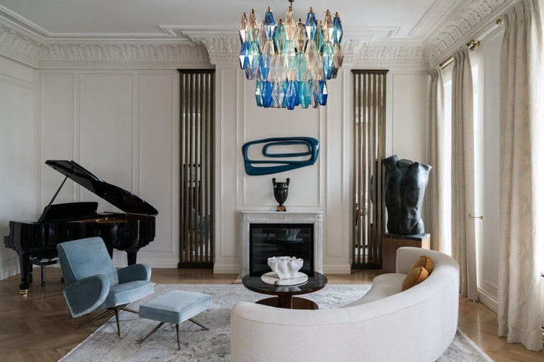 This fantastic chandelier consists with 128 colored Poliedri glass of Murano. Sapphire color variation with heavenly and aquamarine precious Poliedri. Measures: Height without chain and canopy 50 cm (20 inches). With chain and canopy cm 110 (43.5