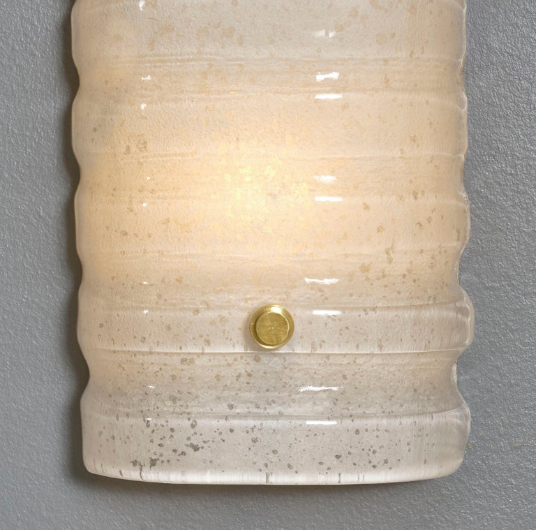 "Murano glass pair of ""scavo"" sconces in an hand-blown ivory color. Each sconce was created using the"