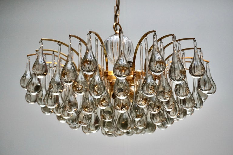 A stunning chandelier, made by Palwa, Germany, circa 1970-1979. It's composed of Murano teardrop Crystal glass pieces on a gilded brass frame. Best of the 1970s from Germany.   The light requires ten single E27 screw fit lightbulbs (40Watt max.)