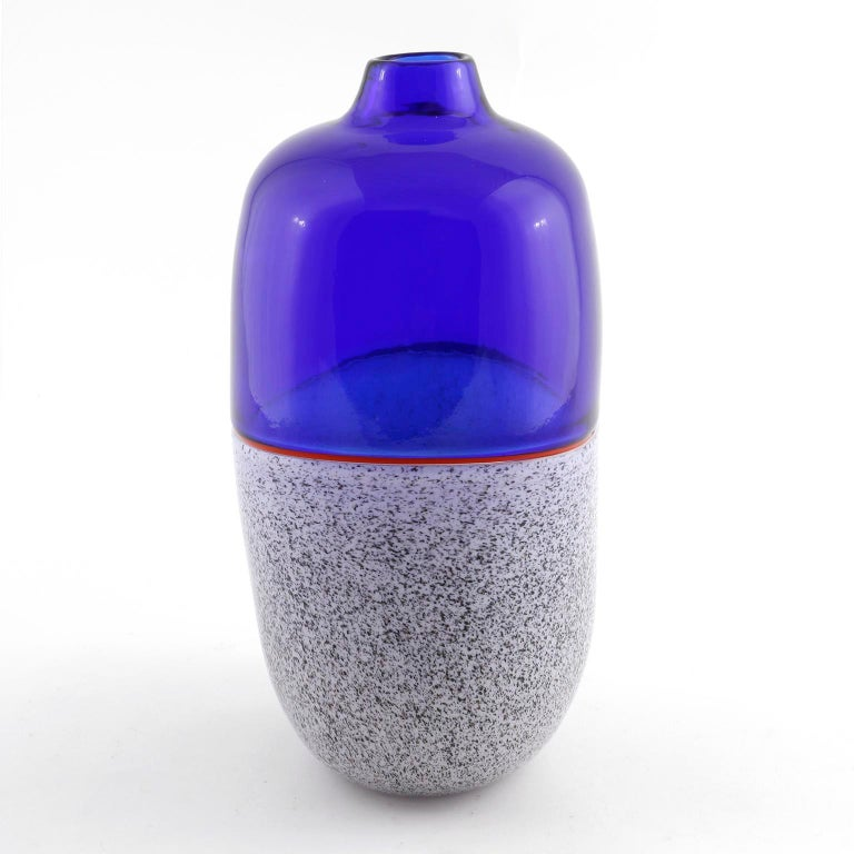 A beautiful Italian glass vase from the 'Istria series' by Lino Tagliapietra and Marina Angelin for Effetre International, Murano, 1986. It is made of hand blown glass composed of blue, red, white, brown and black glass. There is still an Effetre