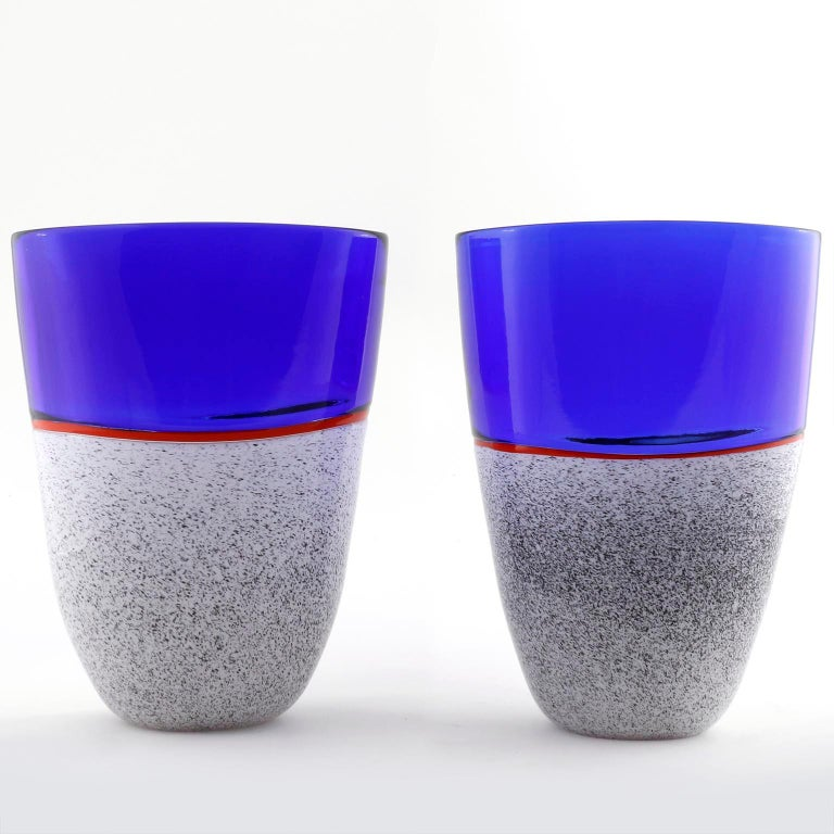 One of two beautiful and rare Italian glass vases from the 'Istria series' by Lino Tagliapietra and Marina Angelin for Effetre International, Murano, 1986 and 1988 The vases are made of hand blown glass composed of blue, red, white, and black