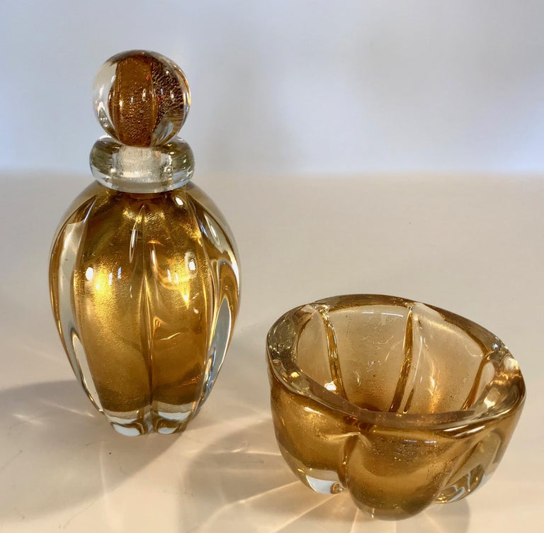 Murano glass set consisting of a stoppered bottleor jar and bowl by Seguso, Murano, Italy. Thick glass in the sommerso technique with brown glass encased in thick ribs of clear glass and delicate gold inclusions.  Stoppered jar is 7.25