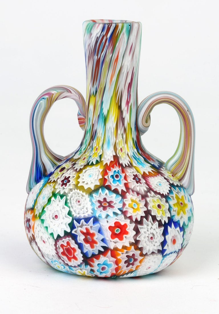 A very fine Art Deco Italian Murano satin glass millefiori twin handled vase dating from circa 1930-1940. This quality vase is of small bottle shape with a rounded bulbous body and tall slender neck with loop handles applied to either side of the