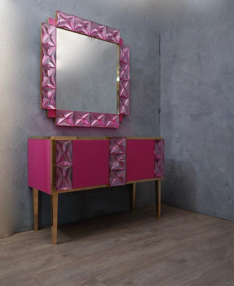 A strong pink frame, reach the eye of the beholder, leaving him entranced; of Murano pink art glass wall mirror.   The structure of the wall mirror is in wood, where the pink Murano glass is housed. The frame of the mirror is made up of a series of