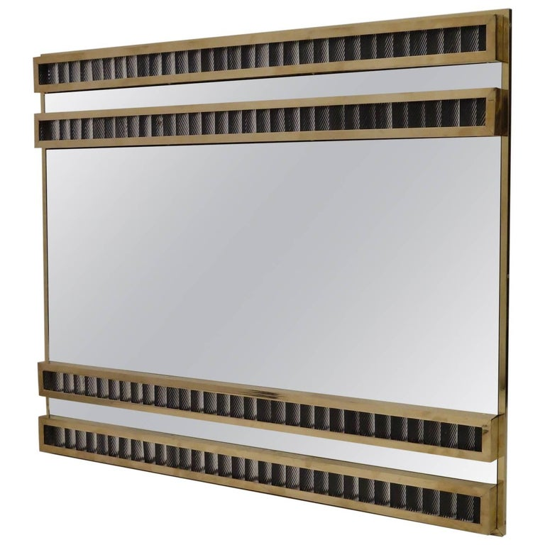 Feature and Classic Murano wall mirror from the mid-century.