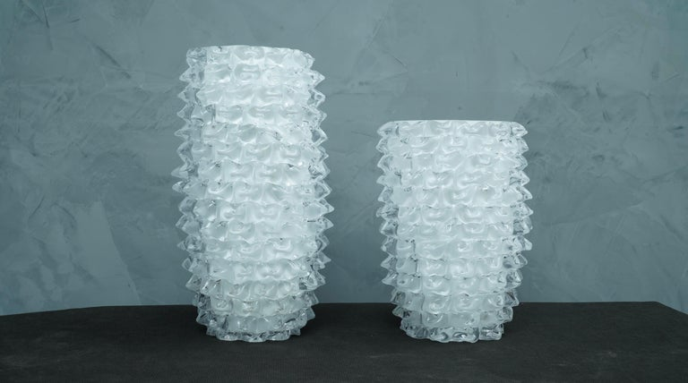 Fantastic vase from the Murano glassworks, both for its special processing and for its double color, in fact the vase is transparent but has an internal white coating, called