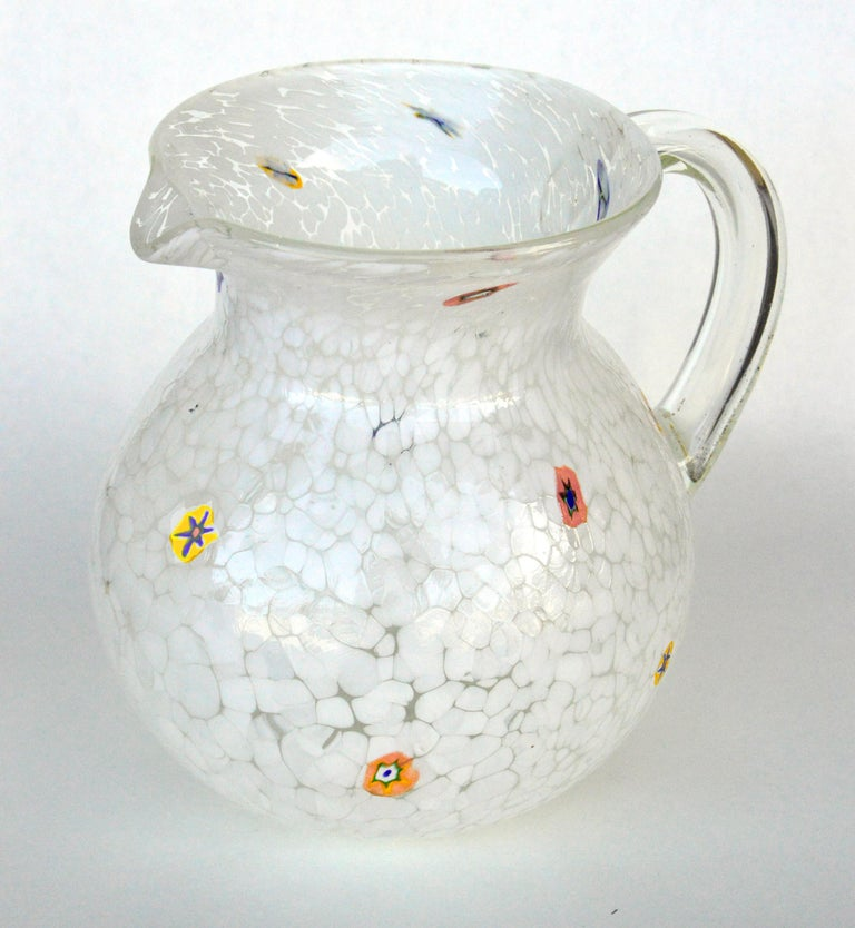Art glass water pitcher by Murano, Millefiori design. Measures: 8