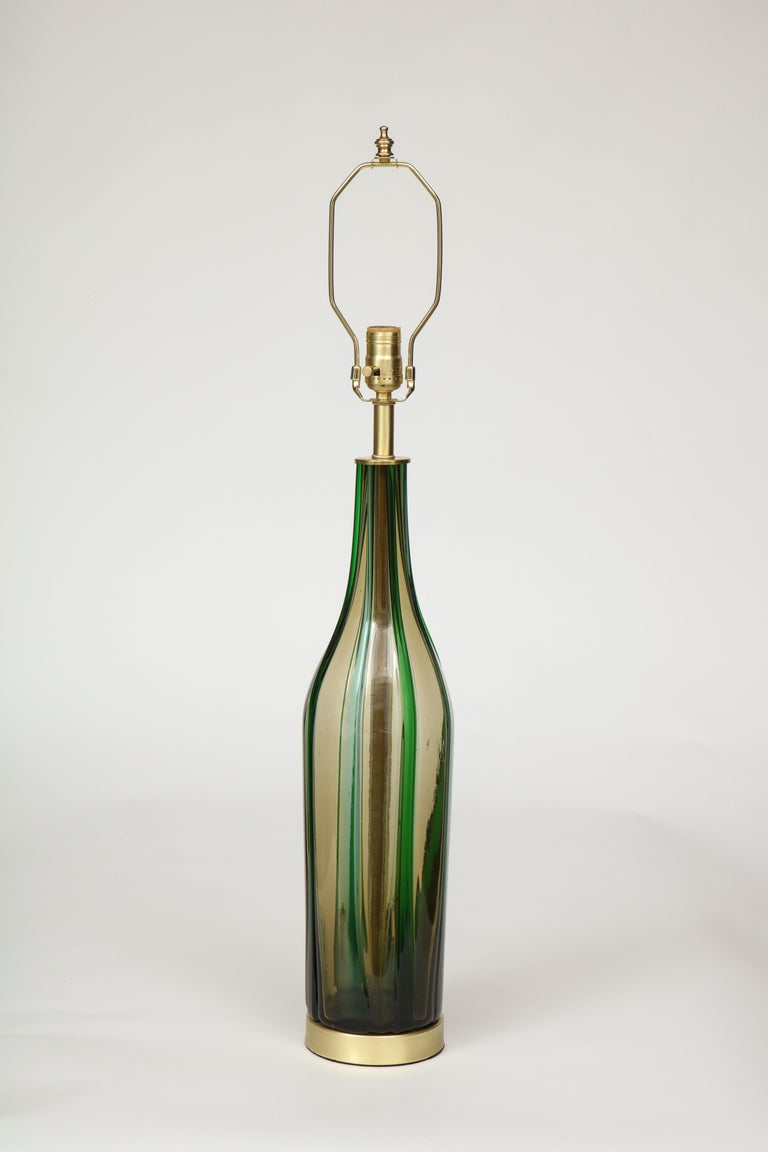 Pair of bottle form Murano glass lamps in olive green with applied vertical stripes, sitting on satin brass bases. Rewired for use in the USA, 100W max bulbs.
