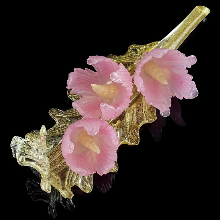 Gorgeous vintage Murano hand blown opalescent pink flowers and gold flecks Italian art glass centerpiece sculpture. The beautiful flowers are attached to a branch, creating a spectacular display piece for a table or dresser. Profusely covered in