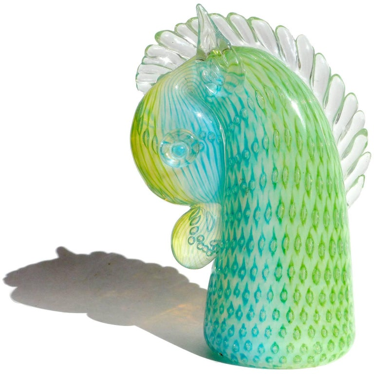 Cute vintage Murano hand blown opalescent green, blue with controlled bubbles Italian art glass horse head paperweight / sculpture. Documented to the Fratelli Toso Company, and still retains a partial