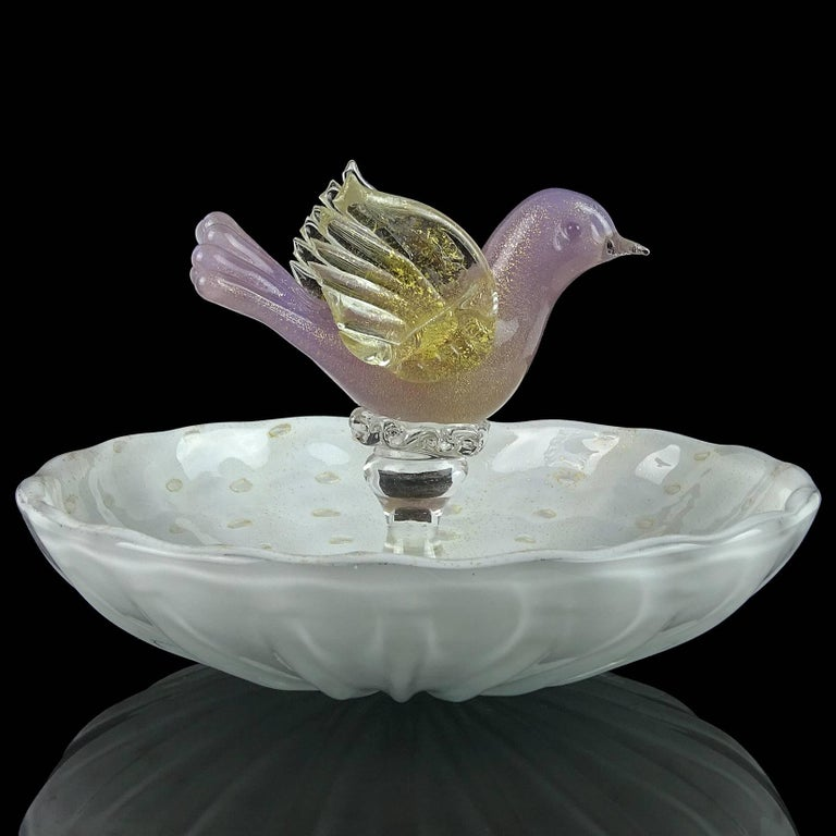 Beautiful Murano hand blown controlled bubbles, white and purple bird Italian art glass bowl. Attributed to designer Alfredo Barbini, for Salviati. Profusely covered in gold leaf. Would make a great candy dish or jewelry or ring dish. Measures 5