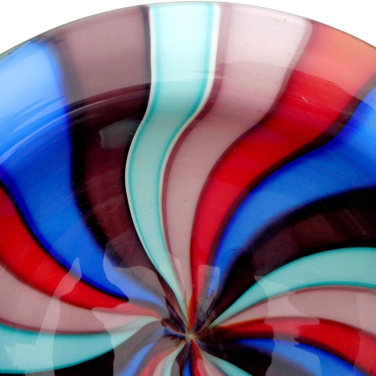 Beautiful vintage Murano hand blown teal, cobalt blue, dark purple, lavender, pink and red Italian art glass decorative bowl. Created in the manner of the Cenedese Company. The piece is thick and heavy, with outer white layer. Can be used as a